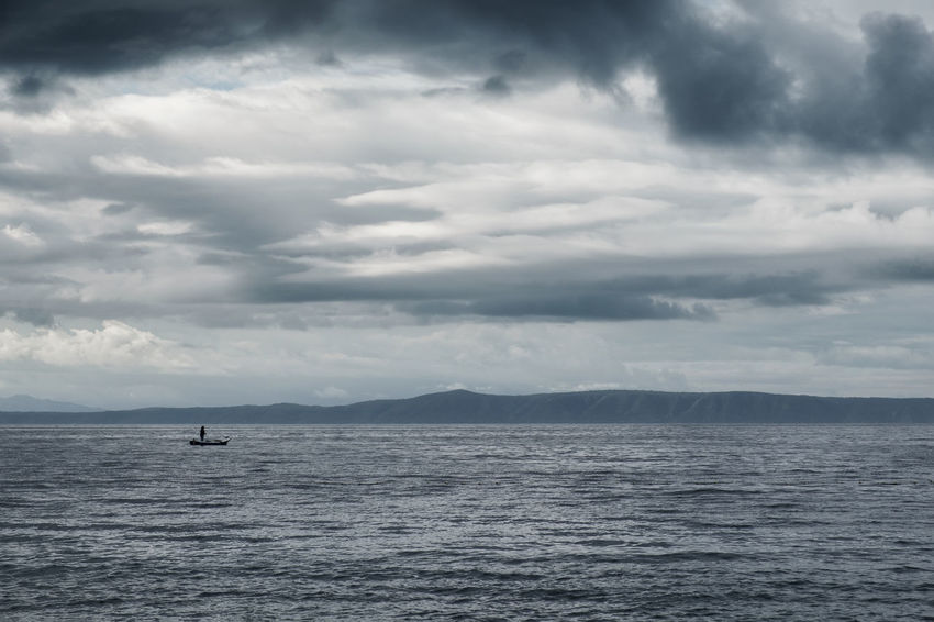 The Old Man and the Sea // Coastline Copy Space Dramatic Sky Silhouette Adriatic Sea Boat Cloud - Sky Distant Fisherman Gray Horizon Over Water Island Minimalism Nature Nautical Vessel One Man Only Outdoors Raincloud Rippled Scenics Sea Storm Cloud Tranquility Water Waterfront