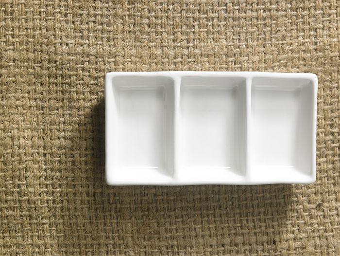 High Angle View Of Empty Egg Carton On Burlap