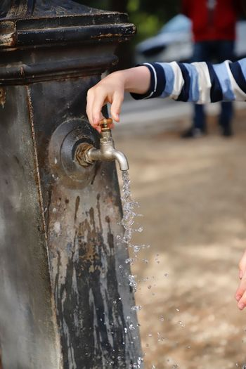 Water Play Washing Washing Hands Hand Human Hand Human Body Part Cleaning Clear Water Outdoors Fountain Watering Watering Place Boy Child Real People Focus On Foreground