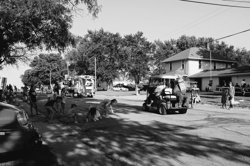 Old Settlers Picnic - Village of Western, Nebraska July 21, 2018 Americans B&W Collection Camera Work Community Event Getty Images Photo Essay Rural America Village Of Western, Nebraska Visual Journal Watching A Parade Architecture Building Exterior Built Structure Car City Day Eye4photography  Group Of People Incidental People Land Vehicle Long Form Storytelling Men Mode Of Transportation Monochrome Motor Vehicle My Neighborhood Nature Old Settlers Picnic Old Settlers Picnic 2018 Outdoors Parade Photo Diary Plant Real People Road S.ramos July 2018 Schwarzweiß Sky Small Town Stories Street Streetphoto_bw Streetphotography Transportation Tree The Street Photographer - 2018 EyeEm Awards