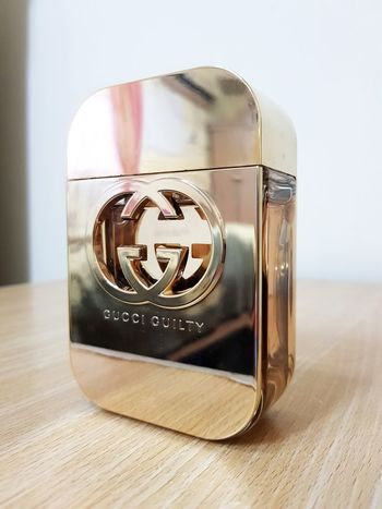 Parfume Parfume Bottle GUCCI GUCCI GUILTY Scent Scented Gold Gold Colored Golden Golden Color Design Designing Brand Brands  Parfumes Luxurious Glamour Glamour Shots Glamorous  EyeEm Selects Old-fashioned Close-up