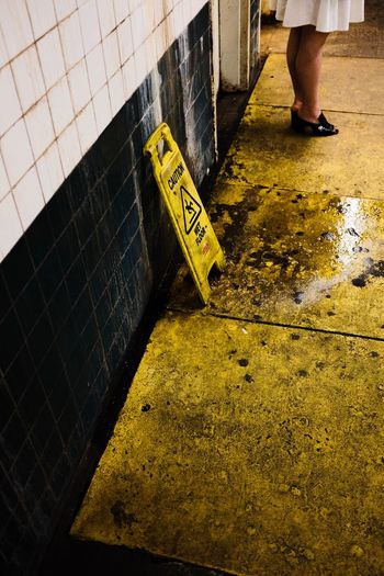 Fujifilm_xseries Communication Sign Text Yellow High Angle View Day The Street Photographer - 2018 EyeEm Awards Street Human Body Part Symbol Warning Sign Human Leg Outdoors Tile Low Section Sunlight Body Part Western Script One Person Flooring City
