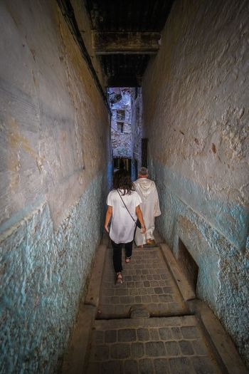 Playing follow the leader this time, we made the mistake of not hiring a guide our first day. You will 100% get hustled if you don't hire a guide, you will get lost just flow with it. Fes is ancient, also a maze and a labyrinth, combined. Travel Destinations Travel Photography Digital Nomad EyeEmNewHere Morocco Fes Morocco Architecture Full Length Built Structure Real People One Person Wall - Building Feature Women Lifestyles The Way Forward Rear View Walking Adult Direction Staircase Footpath Building Men Day Leisure Activity Outdoors Alley Stone Wall Paving Stone