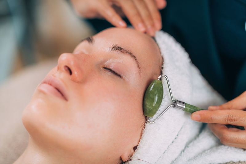 Woman lying for beauty treatment at spa
