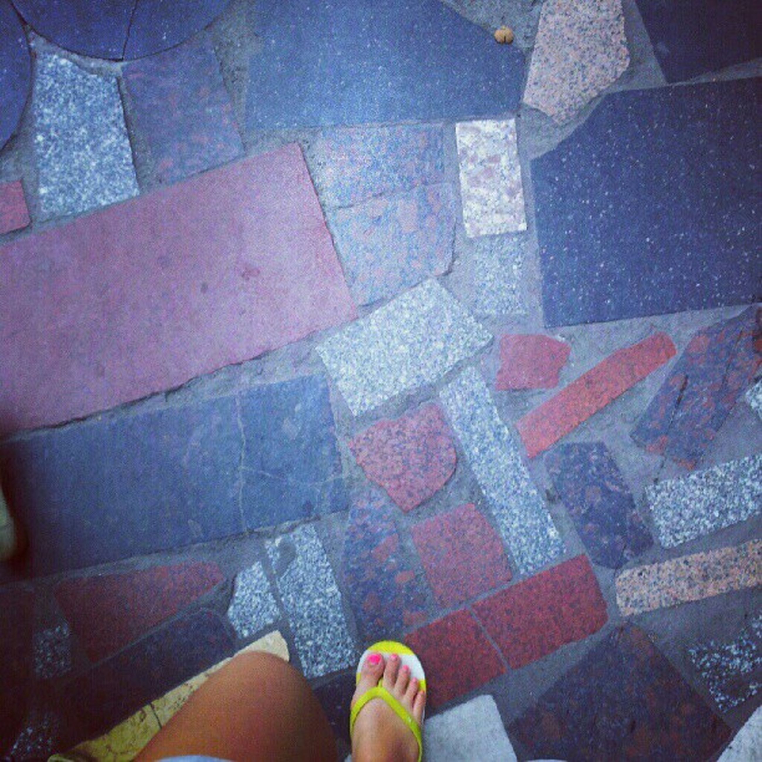 low section, person, personal perspective, human foot, high angle view, standing, shoe, lifestyles, leisure activity, unrecognizable person, men, street, footwear, directly above, tiled floor, paving stone