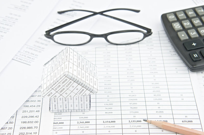 High angle view of eyeglasses and calculator on financial documents