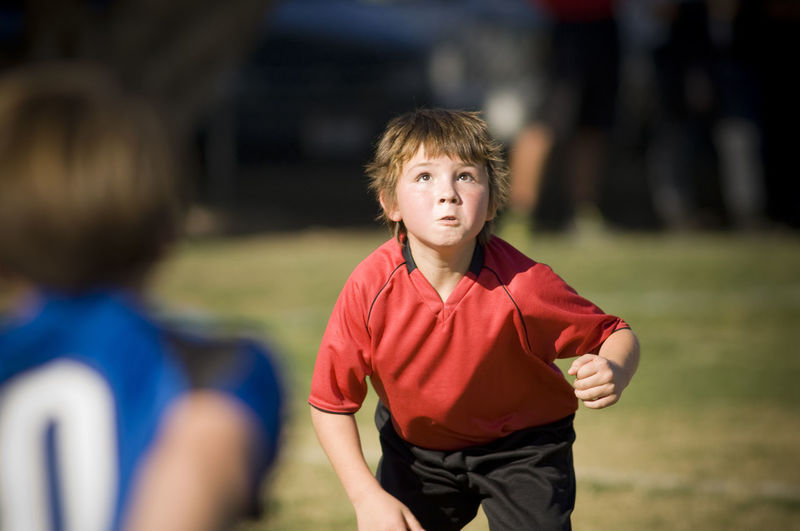 Portrait of boy on soccer field