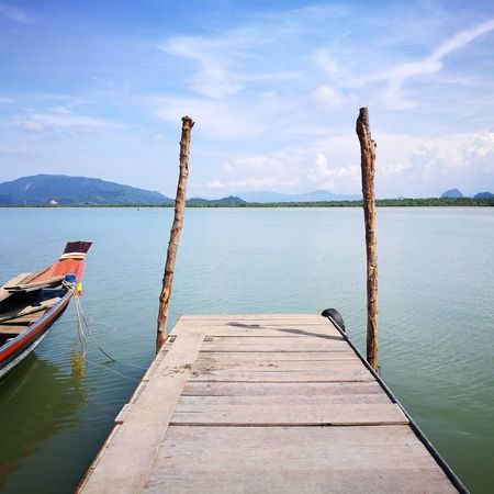 Nature Outdoors Beauty In Nature Water Landscape Wood - Material Tranquility Lake Day Travel Destinations Cloud - Sky No People Sky Scenics