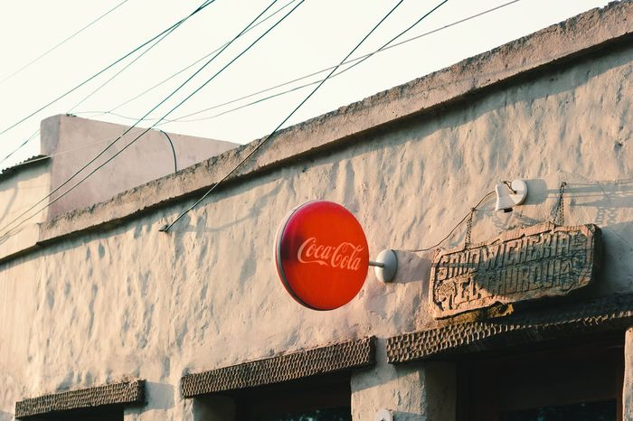 Sign Communication Architecture Hanging Day Sunset Close-up Text Cocacola Built Structure Outdoors No People Red Building Exterior Warm Latin America Argentina Tilcara Sandwich Bar Bar