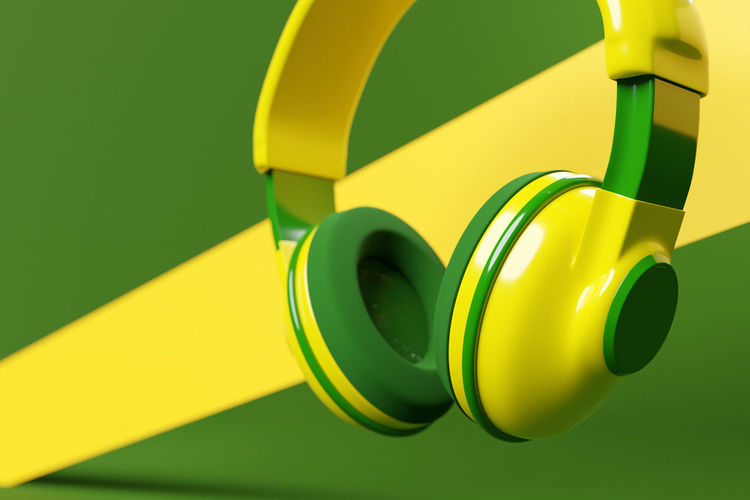 Close-up of yellow toy over green background