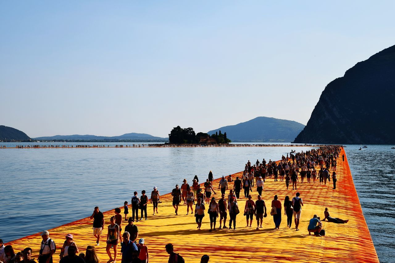 Pedestrians walking on the floating piers over lake
