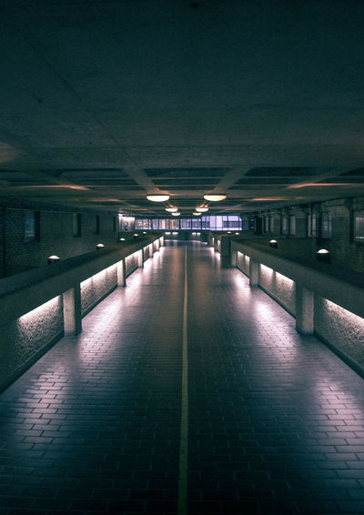 Picture of an alley in the Barbican with a 70s vibe. 70s Architecture City Of London Cool Film Freshness London Nightphotography Old School Adventure Architecture Barbican Basement Built Structure Ceiling Color Empty Illuminated Indoors  Lighting Equipment Night No People Parking Garage The Way Forward Underground