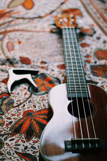 My beautiful uke. Ukulele Ukulele Lover Ukulele Time Ukuleles Uke Ukulele Session Bed Cozy Light Ukulele Learning Ukulele Underground Soprano Soprano Ukulele Capo Music Guitar Light And Shadow Girl Instruments Instrument Low Angle View Room Bedroom Music Brings Us Together Beautiful