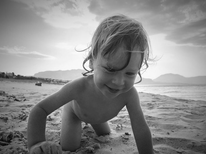 Happy kid playing on the beach