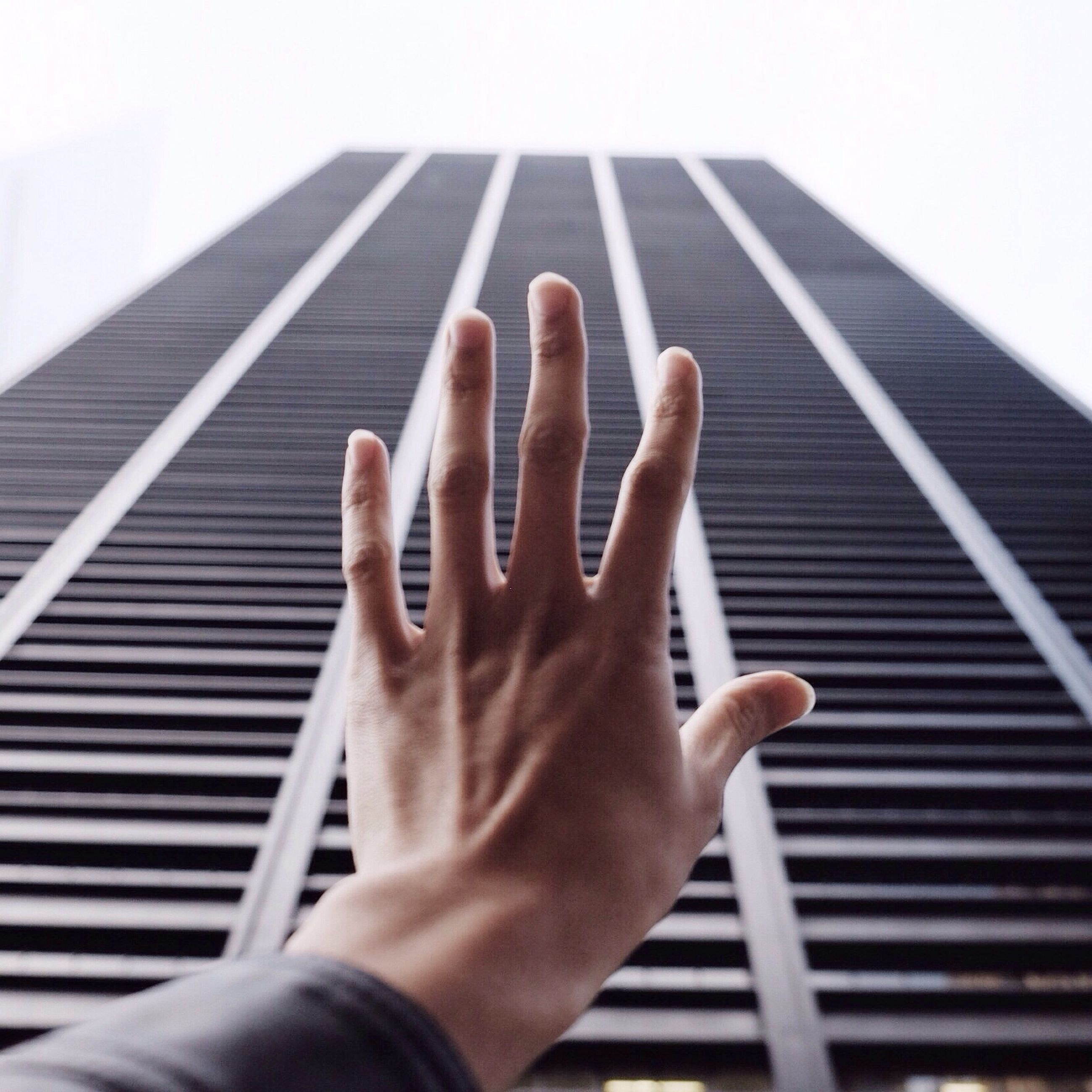 person, personal perspective, part of, human finger, cropped, holding, unrecognizable person, lifestyles, people, one man only, low angle view, close-up, leisure activity, day, railing, built structure