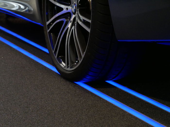 Asphalt Black Color Blue Chrome City Close-up Curve Indoors  Land Vehicle Mode Of Transportation Motor Vehicle Night No People Road Road Marking Sign Speed Spoke Street Surface Level Tire Transportation Wheel 17.62°