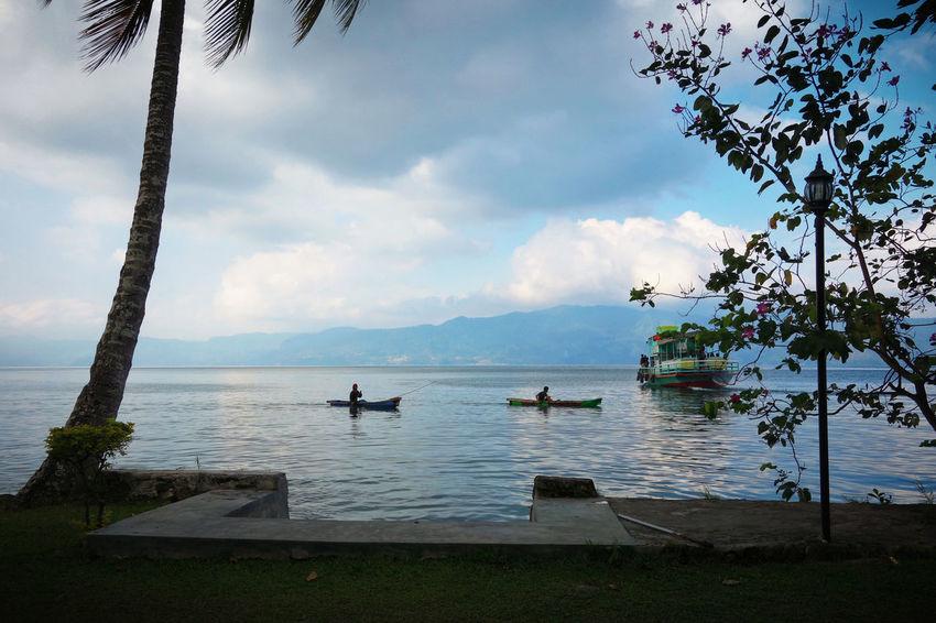 Sumatra  Toba Lake Beauty In Nature Cloud - Sky Day Men Nature Nautical Vessel Outdoors People Real People Scenics Sea Sky Tree Water