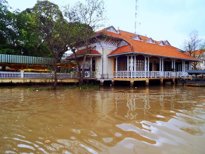 My Little River Shack ~ Architecture Building Exterior Built Structure Day Houseboat Mekong Delta Nature No People On The Water Outdoors Red Roof River View Sky Stilt House Tree Verandahview Water Waterfront