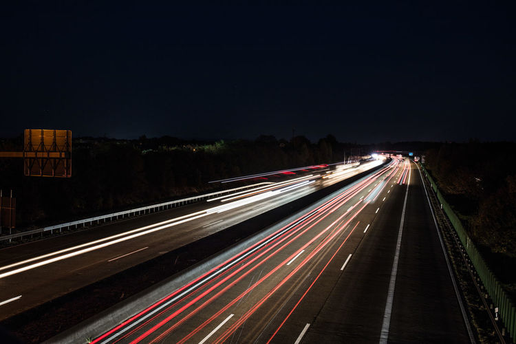 Light Trail Long Exposure Motion Illuminated Speed Transportation Road Night Blurred Motion City Sky Traffic Highway Nature Street No People Copy Space Architecture The Way Forward City Life Outdoors Multiple Lane Highway Vehicle Light