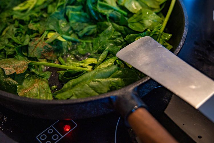 High angle view of chopped spinach in pan