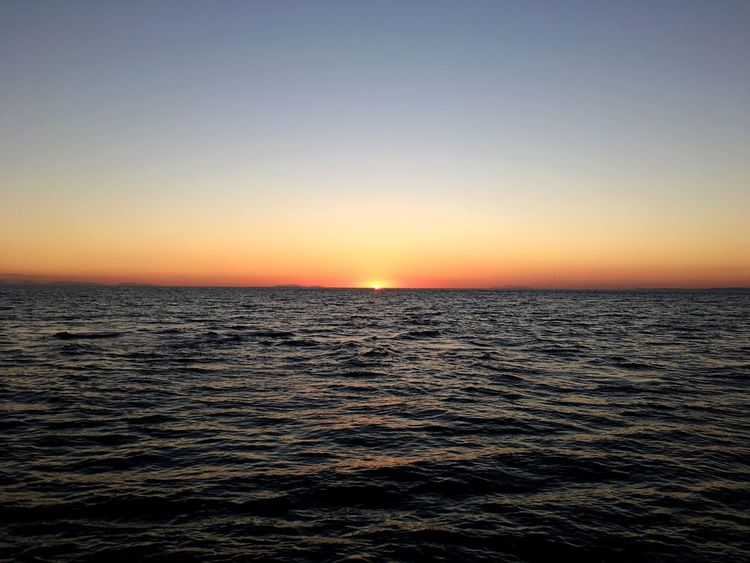 Sunset Sea Tranquility Clear Sky Nature Scenics Beauty In Nature Horizon Over Water Tranquil Scene Water Waterfront No People Sky Outdoors Day Beauty In Nature Nature