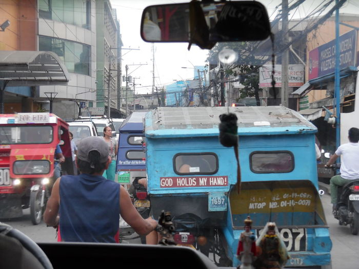 """Traffic in Manila """"God holds my hand!"""" Car Day Land Vehicle Live In Manila Manila City Hall Manila, Philippines ManilaStreetPhotography Outdoors People Public Transportation Real People Traffic Transportation EyeEmNewHere Capture The Moment City Street City Life No Edit/no Filter Lifestyle Network"""