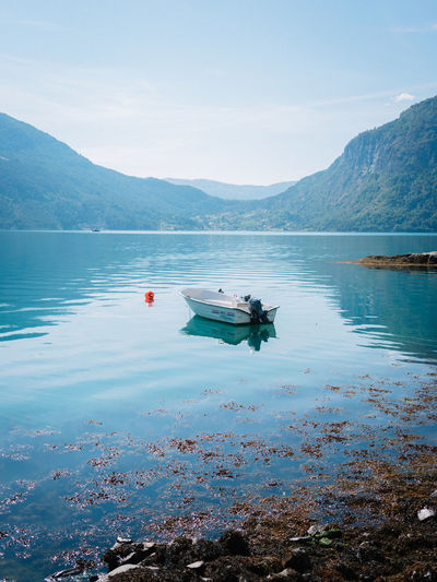 Fjordsofnorway Beah Beauty In Nature Boat Day Fjord Fjørd Floating On Water Idyllic Lake Mode Of Transportation Mountain Mountain Range Nature Nautical Vessel No People Non-urban Scene Outdoors Reflection Scenics - Nature Sky Tranquil Scene Tranquility Transportation Water