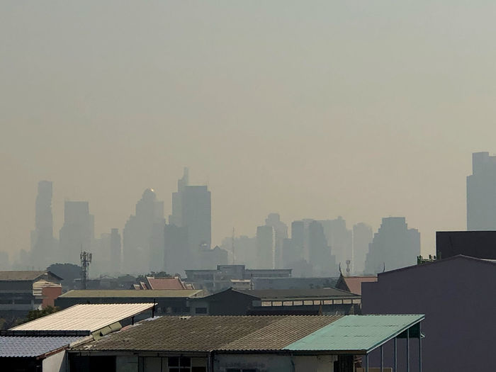 Buildings in city against sky