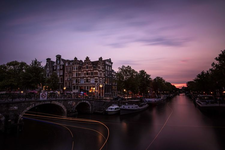 And another EyeEm Best Shots EyeEm Long Exposure Amsterdam Canal Water Architecture Sky Illuminated Nautical Vessel Built Structure Night Dusk Building Exterior Transportation Mode Of Transportation City Reflection No People Tree Cloud - Sky Plant River The Traveler - 2018 EyeEm Awards