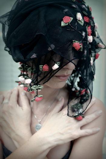 Close-Up Of Woman Wearing Black Veil