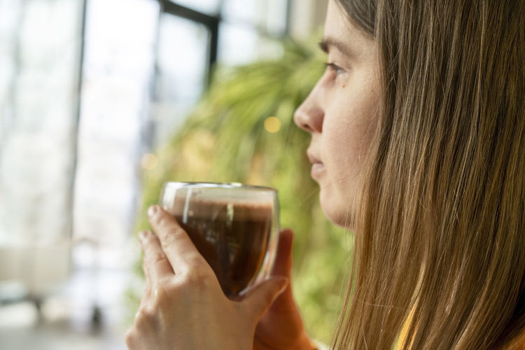 Close-up portrait of a woman drinking glass