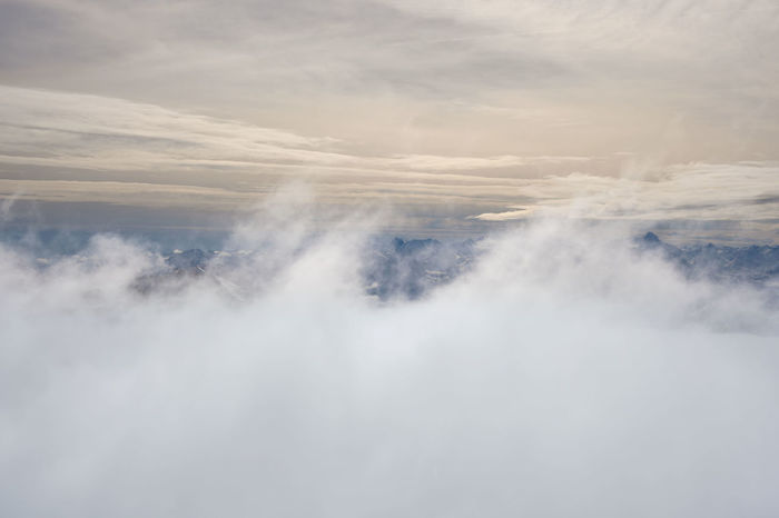 Mountain range in the Italian alps being partially covered by a layer of clouds , region of the valley of Aosta. Beauty In Nature Cloud - Sky Fog Mountain Range Nature No People Outdoors Scenics