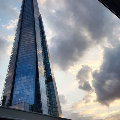 View from a train station Theshardlondon Trainstation Lookingup Cloud Cloudscape Cityscape Sunset_collection Dusk In The City London lifestyle Citylife London Colour Illuminated Steel Occupation Tower Office Building Tall Skyline Architectural Feature Spire  Financial District  Looking Through Window Tall - High #urbanana: The Urban Playground