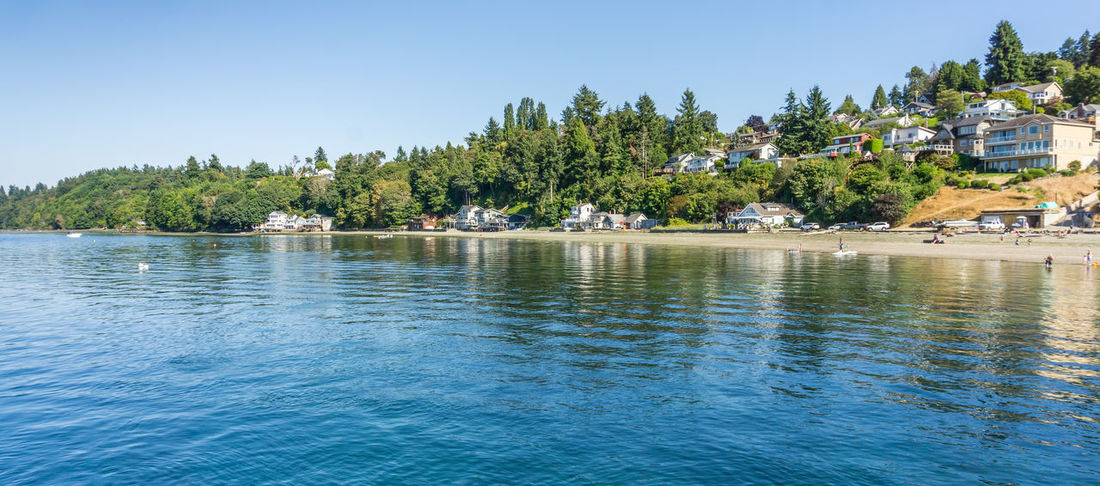 A view of the shoreline in Dash Point, Washington. Architecture Beauty In Nature Building Exterior Built Structure Dash Point Day Lake Nature Nautical Vessel No People Ocean Outdoors Plant Scenics - Nature Shoreline Sky Tranquil Scene Tranquility Transportation Tree Water Waterfront