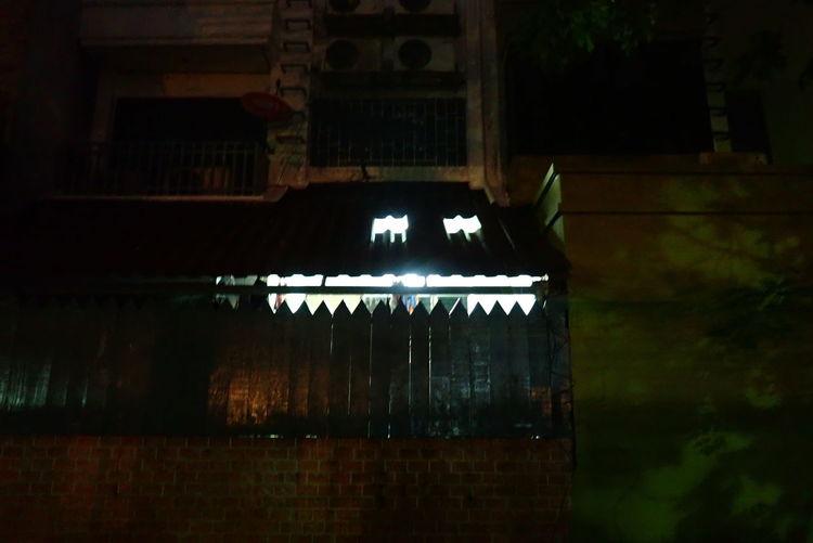 Text on illuminated building at night