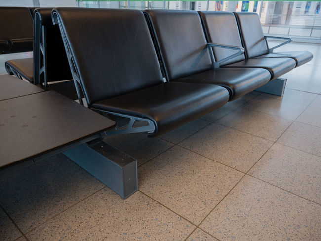 Absence Airport Airport Departure Area Airport Terminal Chair Day Empty Flooring Furniture In A Row Indoors  Modern No People Seat Table Tile Tiled Floor Transportation Travel Waiting Room