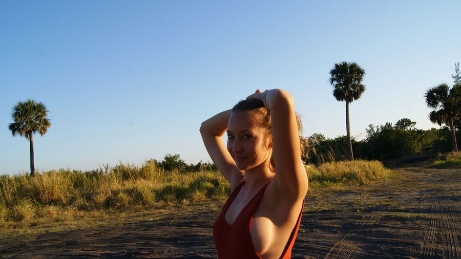 Ponny Tail Hair Style American Normal Sunset Golden Sunrise Portrait Woman Female Model Face HEAD Red Swimsuit Blonde Blue Eyes Boobs Field Beach Young Looking Fashion Smile Smiling Confident  Young Free