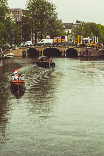 Amsterdam Amsterdam Canal Amsterdam With Boats Boat Boats Boats On River Bridge Bridges Bridges Of Amsterdam Canals Mode Of Transport Nautical Vessel Outdoors River Riverscape With Boat Transportation Travel Trip Vacation Water Waterfront Waterscape Your Amsterdam