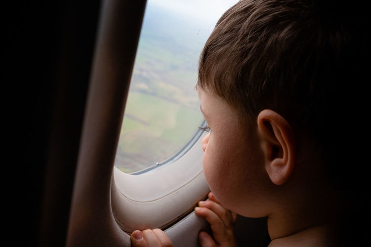 Travelling kids - in the plane Humanity Meets Technology My Best Photo Window One Person Childhood Transportation Boys Headshot Males  Child Vehicle Interior Real People Portrait Airplane Looking Through Window Mode Of Transportation Innocence Human Face Air Vehicle