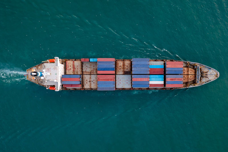 Aerial top view from drone, container ship or cargo shipping business service logistic import