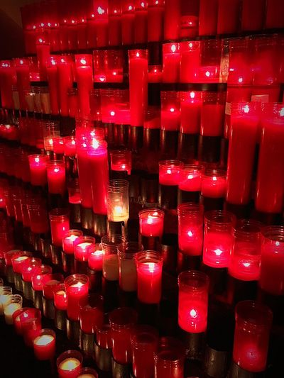 Red Indoors  Candlelight In A Row No People Tradition Large Group Of Objects Travel Destinations Nuria Valley