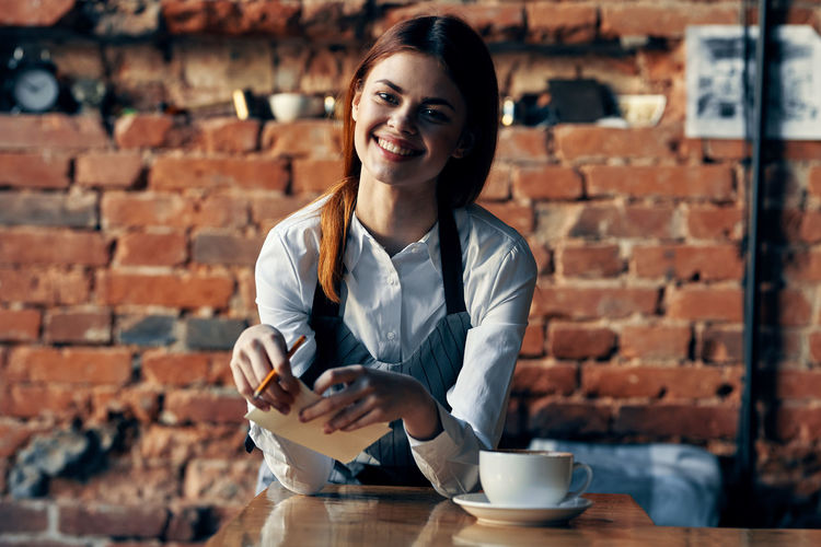Portrait of woman with coffee