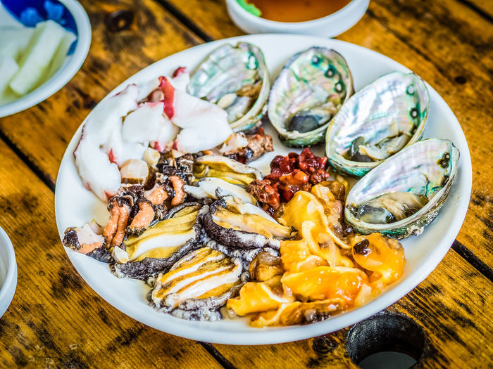 Set of raw seafood served to customer that ready to eat in raw seafood shop near Seongaksan mountain, Jeju island, South Korea. JEJU ISLAND  Jeju Jeju Island, Korea Jeju-do Ready To Eat SHELLFISH  Seafood Seafood Market Seongaksan Jeju Squids Close-up Day Food Food And Drink Freshness Healthy Eating Indoors  Jeju Travel Octopus Raw Food Raw Seafood Raw Seafood Shop Ready-to-eat Seafood Restaurant Snailshell