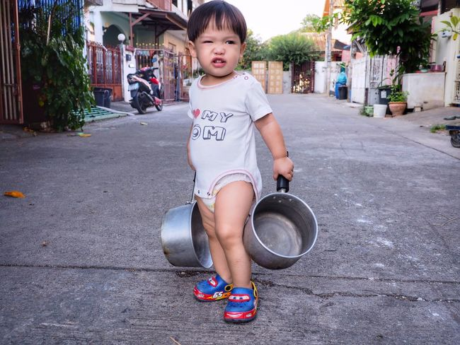 Funny Kid Pot Giggle Relaxing Road Floor Standing Boy Kids Portrait Kid Funny Faces Funny One Person Childhood Day Outdoors Looking At Camera Full Length Portrait Real People Children Only