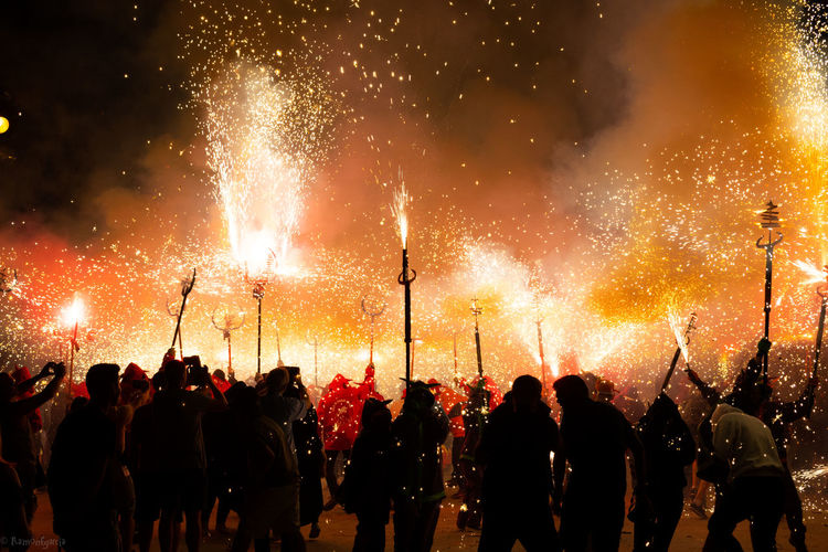 People with firework at night during event