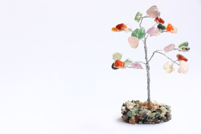 Colorful stones tree. Composition Detail Fragility Hand Handmade Stones Studio Shot Top Perspective White Background