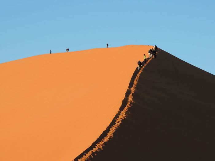 Memories of Sossusvlei Sossusvlei Namibia Orange Color Hike Sky Land Desert Sand Dune Scenics - Nature Sand Landscape Nature Climate Beauty In Nature Clear Sky Tranquil Scene Tranquility Environment Arid Climate Non-urban Scene Travel Outdoors 17.62°