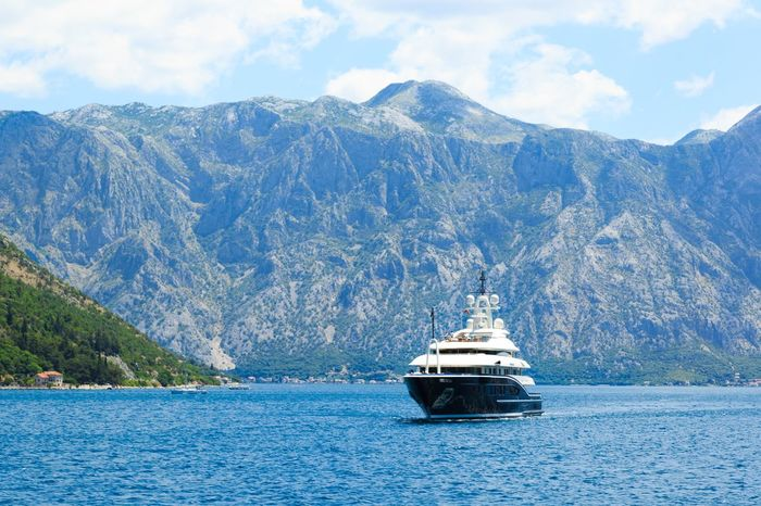 Luxury motor yacht cruising in the Bay of Kotor, Monenegro Bay Of Kotor Billionaire  Luxury Yacht Cloud - Sky Day Kotor Luxury Luxury Yachts Mode Of Transport Montenegro Mountain Nature Nautical Vessel No People Outdoors Sea Sky Transportation