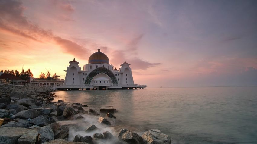 Magnificent Sunriseat Strait Mosque of Malacca, Malaysia. Sunset Architecture Travel Destinations Politics And Government Business Finance And Industry Sky Dome Reflection Dusk Government No People Building Exterior Clear Sky Night City Water Outdoors Religion Praying Nature Spirituality Architecture Sunset Silhouettes Glow In The Dark Spirituality malacca tourism