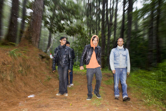 Four man walking around the trees. Friendship Lifestyles Looking At Camera Man Men Real People Togetherness Walking